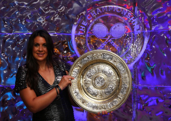 Marion Bartoli of France poses with the Venus Rosewater Dish trophy at the Wimbledon Championships 2013 Winners Ball. BBC commentator John Inverdale made rather insensitive comments after she claimed her maiden Grand Slam. (Getty Images)