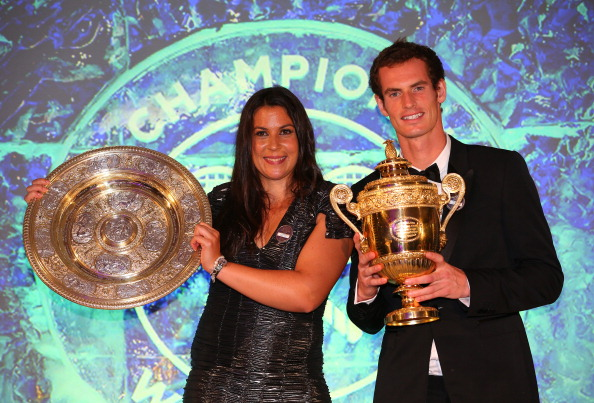 Marion Bartoli of France poses with the Venus Rosewater Dish trophy and Andy Murray of Great Britain poses with the Gentlemen's Singles Trophy at the Wimbledon Championships 2013 Winners Ball at InterContinental Park Lane Hotel on July 7, 2013 in London, England.  (Getty Images)