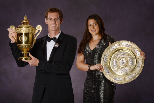 Andy Murray of Great Britain poses with the Gentlemen's Singles Trophy and Marion Bartoli of France (R) poses with the Venus Rosewater Dish trophy at the Wimbledon Championships 2013 Winners Ball at InterContinental Park Lane Hotel on July 7, 2013 in London, England.   (Photo by Bob Martin - Pool/AELTC via Getty Images)