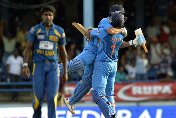 Dhoni (C-L) is lifted off the ground by teammate Ishant Sharma after hitting a six to seal their victory during the final of the Tri-Nation series against Sri Lanka at the Queen's Park Oval stadium in Port of Spain on July 11, 2013. India defeated Sri Lanka by 1 wicket to win the series. (Getty Images)