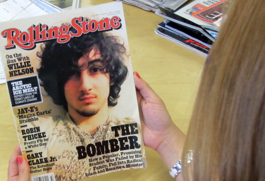 "An early copy of Rolling Stone magazine's August 2013 issue featuring the cover story on Boston bombing suspect Dzhokhar Tsarnaev, which triggered criticism that the magazine was ""glamorizing terrorism"". The  article, titled ""The Bomber,"" was described by the magazine as a ""deeply reported account of the life and times"" of Tsarnaev.  (AFP/Getty Images)"