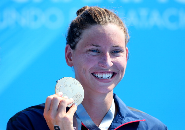 Haley Anderson of USA poses with her gold medal after winning the Open Water Swimming Women's 5k race on day one of the 15th FINA World Championships at Moll de la Fusta on July 20, 2013 in Barcelona, Spain.  (Getty Images)