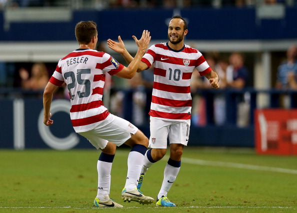 Landon Donovan #10 of the United States celebrates his goal with Matt Besler #25 against Honduras during the CONCACAF Gold Cup semifinal match at Cowboys Stadium on July 24, 2013 in Arlington, Texas.  (Getty Images)