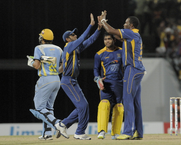Misbah-ul-Haq (L) of St. Lucia Zouks out caught off Barbados Tridents Kieron Pollard (R)at Kensington Oval on July 30, 2013 in Bridgetown, Barbados. (Getty Images)