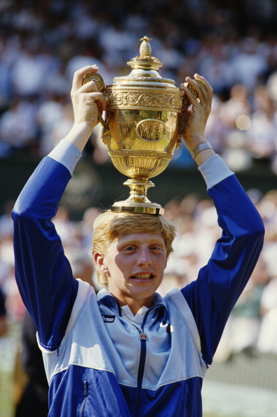 Boris Becker of Germany places the trophy on his head in to celebrate his defeat of Kevin Curren 6-3, 6-7 (4-7), 7-6 (7-3), 6-4 during the Men