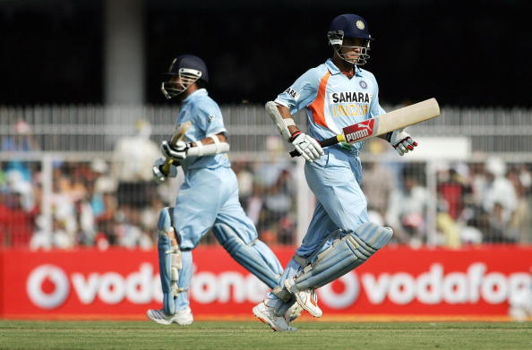 Indian cricketers Sourav Ganguly (R) and