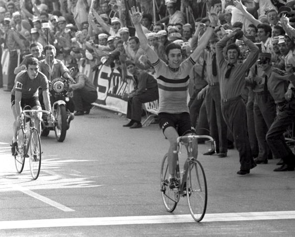 Eddy Merckx raises his arms in celebration as he crosses the line to win the World Professional 168 mile road Championship race