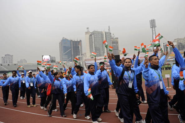 Indian athletes wave their national flag