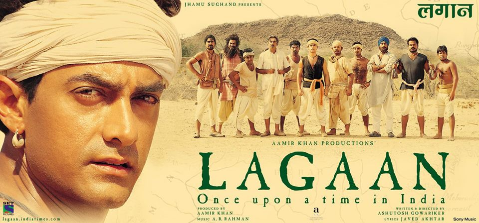 "A cinema-goer looks at a poster of the film ""Lagaa"