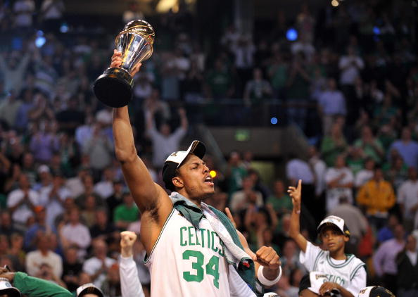 Boston Celtics' Paul Pierce celebrates with his MVP trophy after winning Game 6 of the 2008 NBA Finals in Boston, Massachusetts, June 17, 2008.  The Boston Celtics captured the National Basketball Association championship, routing the Los Angeles Lakers 131-92 to win the best-of-seven NBA Finals four games to two.