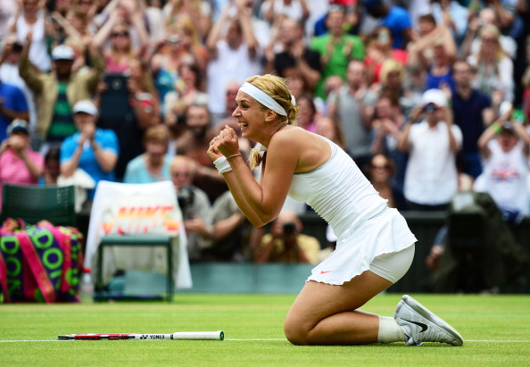 Sabine Lisicki of Germany celebrates match point during her Ladies' Singles fourth round match against Serena Williams of United States of America on day seven of the Wimbledon Lawn Tennis Championships at the All England Lawn Tennis and Croquet Club on July 1, 2013 in London, England.  (Photo by Mike Hewitt/Getty Images)