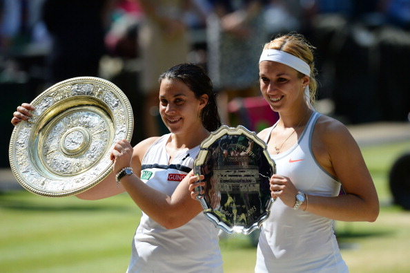 Marion Bartoli of France poses with the Venus Rosewater Dish trophy next to Sabine Lisicki of Germany and her runner-up trophy after their Ladies' Singles final match on day twelve of the Wimbledon Lawn Tennis Championships at the All England Lawn Tennis and Croquet Club on July 6, 2013 in London, England.  (Getty Images)