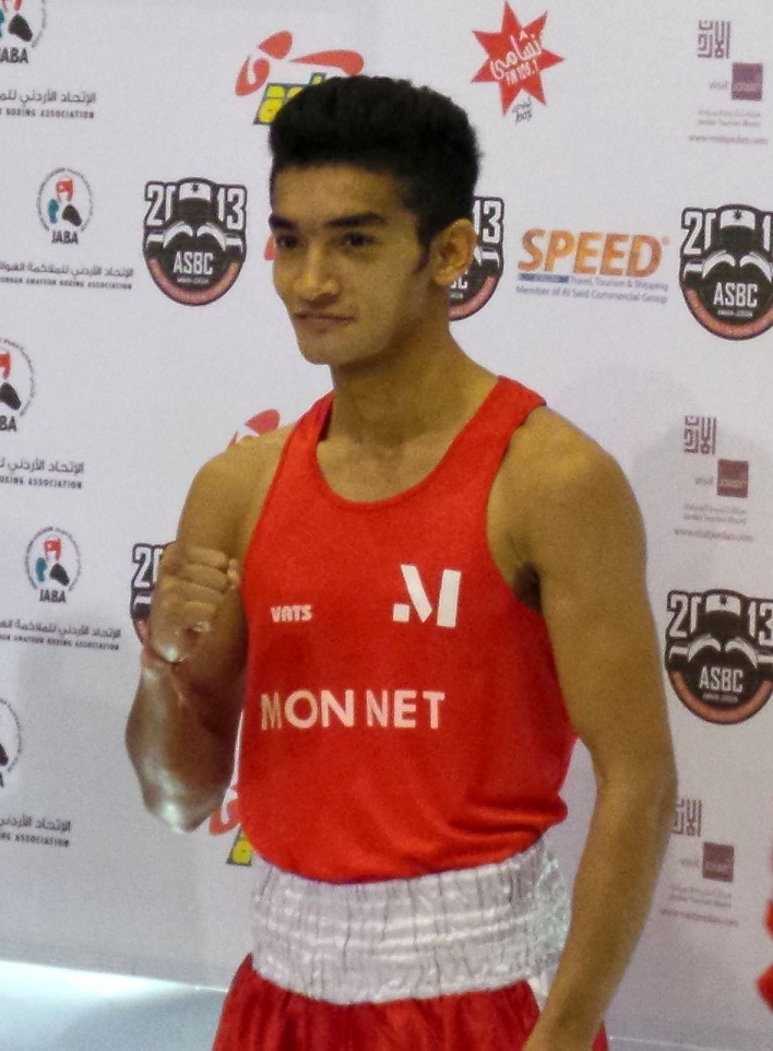 Shiva Thapa (56kg) in his Monnet kit, at the Medal Ceremony in Amman