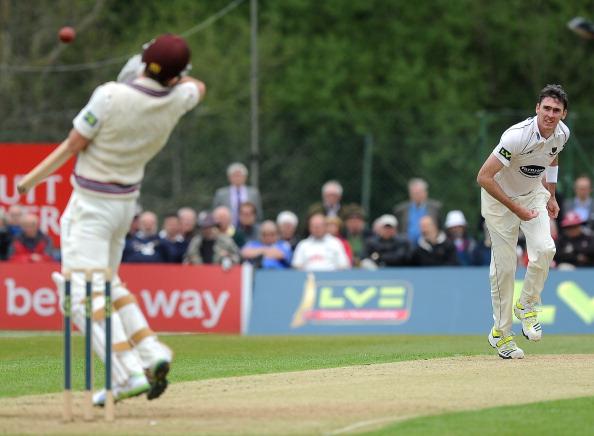 Steve Magoffin bowls a bouncer to a Somerset batsman