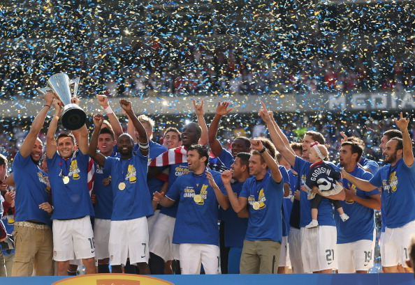 CHICAGO, IL - JULY 28:  Members of the United States celebrate winning the Gold Cup after defeating Panama during the CONCACAF Gold Cup final match at Soldier Field on July 28, 2013 in Chicago, Illinois. The United States defeated Panama 1-0.