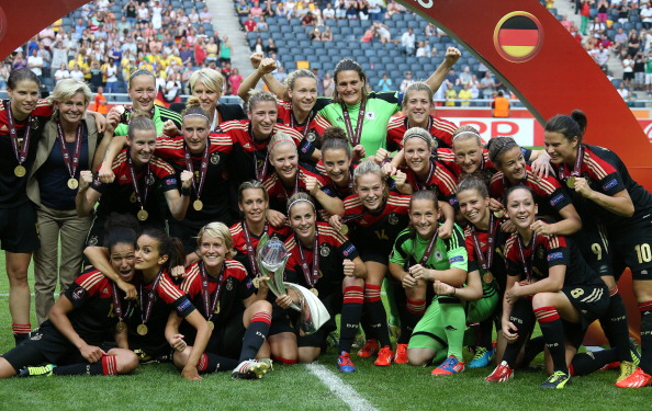 Nadine Angerer, goalkeeper and captain of Germany celebrates the victory with her teammates during the trophy ceremony after the UEFA Women's Euro 2013 Final between Germany and Norway at the Friends Arena Stadium