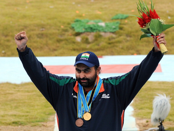 Gold medalist Ronjan Sodhi of India cele
