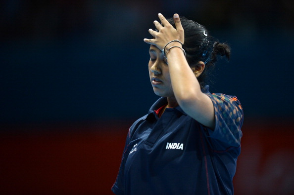 Ankita Das of India reacts after losing