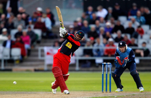 Ashwell Prince (L) of Lancashire plays a shot during the Yorkshire Bank 40 match between Lancashire Lightning and Derbyshire Falcons at Old Trafford on August 13, 2013 in Manchester, England.