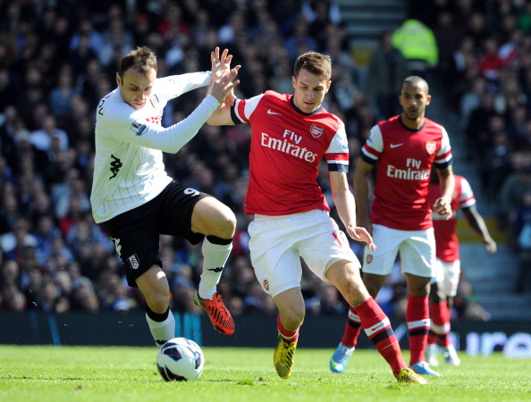 Aaron Ramsey of Arsenal closes down Dimitar Berbatov of Fulham during the Barclays Premier League match between Fulham and Arsenal at Craven Cottage on April 20, 2013 in London, England