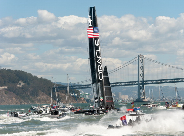 Fleet and spectator boats follow Oracle Team USA as it celebrates its victory over Emirates Team New Zealand in the 34th America's Cup