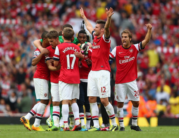 Olivier Giroud of Arsenal celebrates victory after the Barclays Premier League match between Arsenal and Tottenham Hotspur at Emirates Stadium on September 01, 2013 in London, England.  (Getty Images)