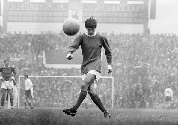 George Best in action for Manchester United, at Old Trafford in Manchester, 1964.