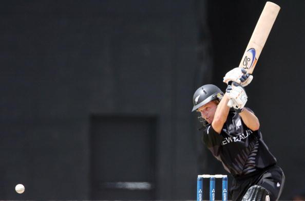 New Zealand's Hamish Marshall plays a shot against Ireland
