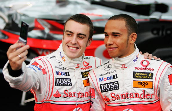 Lewis Hamilton poses with Fernando Alonso during the launch of the Vodafone McLaren Mercedes 2007 MP4-22