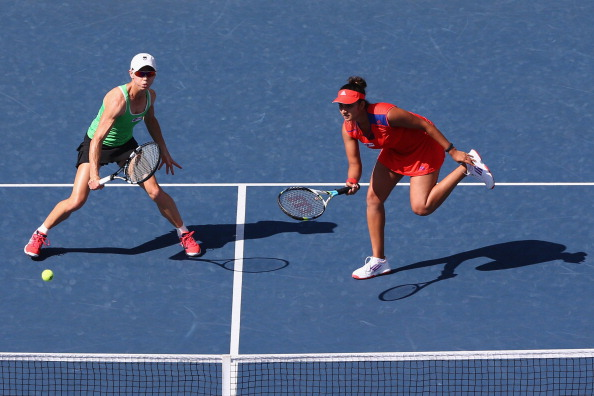 Cara Black of Zimbabwe and Sania Mirza of India in action during their match against Suwei Hsieh of Chinese Taipei and Shuai Peng of China in the womens doubles semi final matc