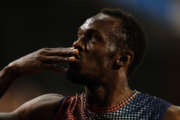 Usain Bolt celebrates after winning the 100m final in Brussels