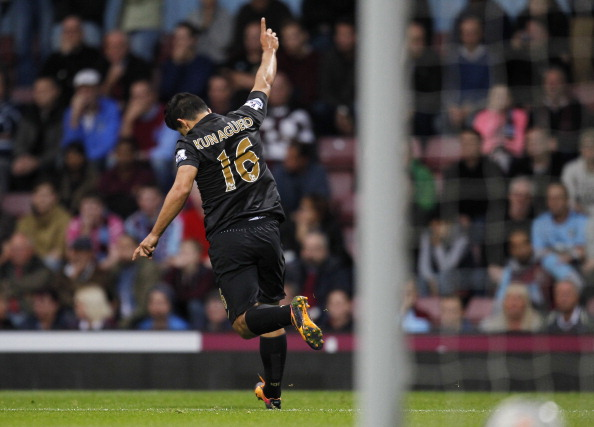 Manchester City's Argentinian striker Sergio Aguero celebrates scoring his goal during an English Premier League football match between West Ham United and Manchester City at Upton Park in London, on October 19, 2013.