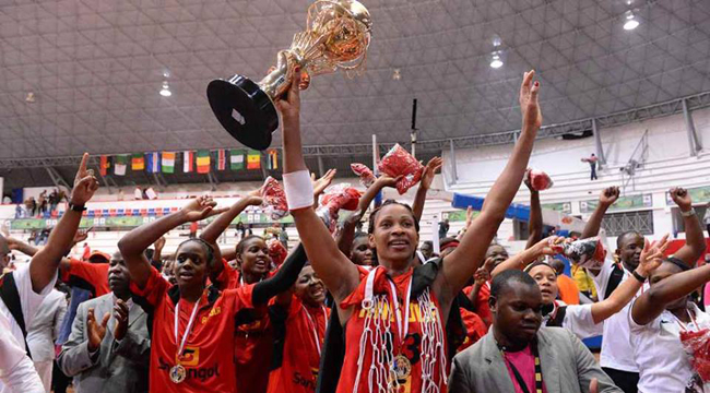 Angola players celebrating their second title in a row