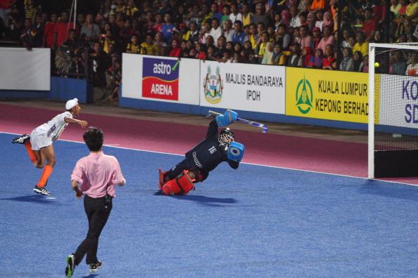Mandeep Singh hits past Malaysia's goalkeeper Subramiam Kumar