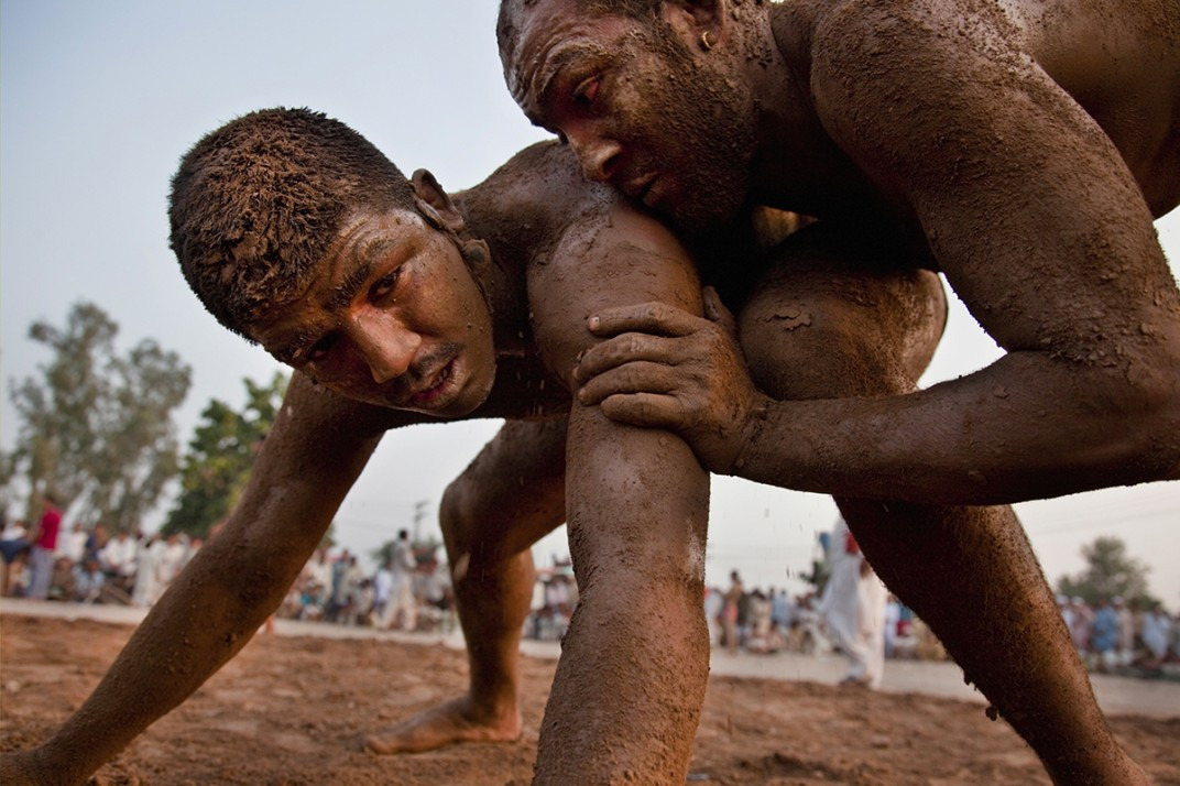 Two Kusti wrestlers in action