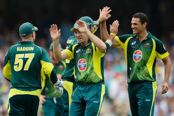 SYDNEY, AUSTRALIA - JANUARY 19:  Nathan Coulter-Nile of Australia celebrates after taking the wicket of Stuart Broad of England during game three of the One Day International Series between Australia and England at Sydney Cricket Ground on January 19, 2014 in Sydney, Australia.  (Photo by Brett Hemmings/Getty Images)