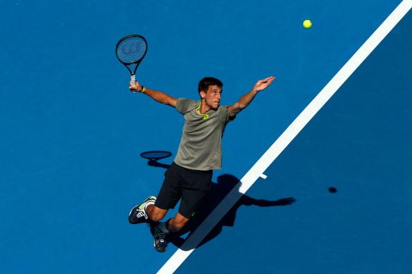 Damir Dzumhur serves during his match against Tomas Berdych at the 2014 Australian Open