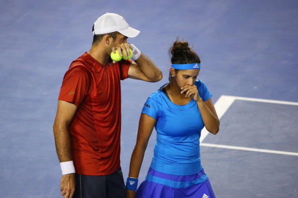 Horia Tecau and Sania Mirza in action during the Australian Open 2014