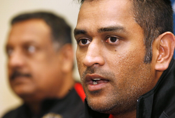 India's cricket captain Mahendra Singh Dhoni (R) speaks during a press conference after the team's arrival at Auckland International Airport for the cricket series against New Zealand on January 13, 2014.  New Zealand and India will play five one-day internationals between January 19 and 31, followed by two Tests in Auckland and Wellington  in February.      AFP PHOTO / Nigel MARPLE        (Photo credit should read Nigel Marple/AFP/Getty Images)