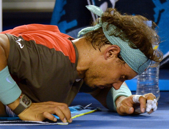 Rafael Nadal during the medical timeout for his back injury during the Australian Open 2014 final against Stanislas Wawrinka