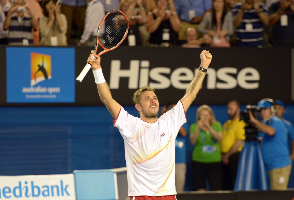 Stanislas Wawrinka and his somewhat muted celebration at winning the 2014 Australian Open title over the injured Rafael Nadal