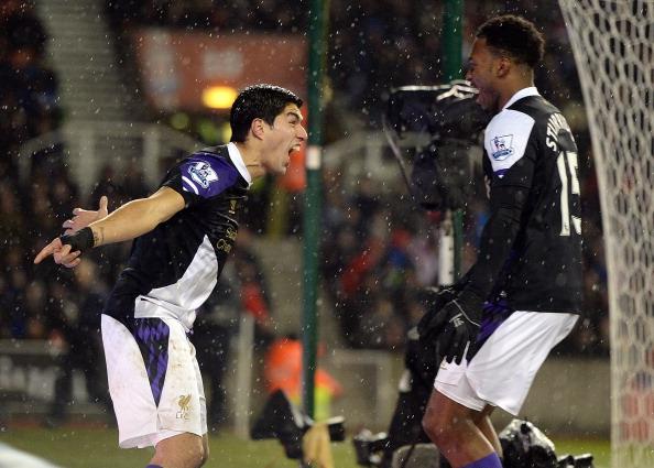 Liverpool's Luis Suarez celebrates after scoring his second goal with Daniel Sturridge.