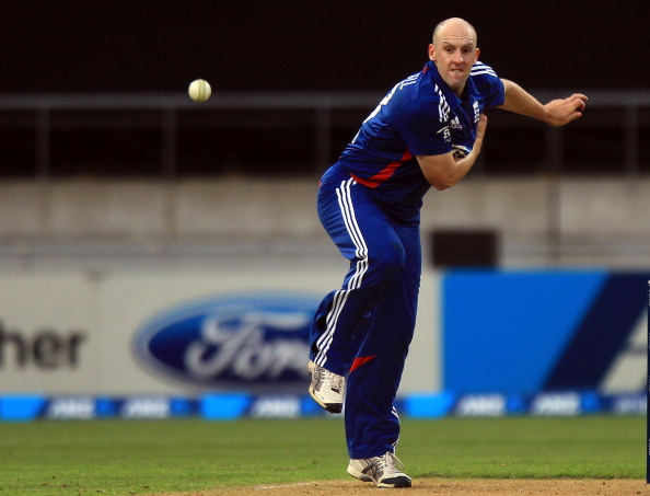 England's James Tredwell bowls during the International Twenty20 cricket match between New Zealand and England played at the Westpac Stadium in Wellington on February 15, 2013.   AFP PHOTO / Marty MELVILLE        (Photo credit should read Marty Melville/AFP/Getty Images)