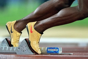 "Michael Johnson's iconic ""golden spikes""."