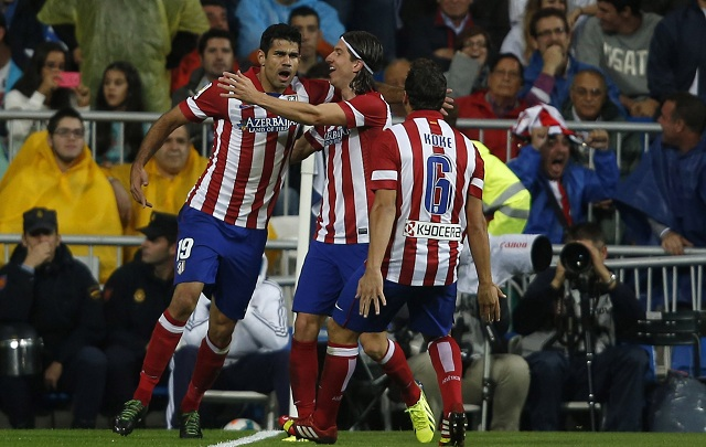Atletico Madrid's Diego Costa celebrates a goal with teammates Filipe and Koke during the Spanish first division soccer match against Real Madrid at Santiago Bernabeu stadium in Madrid