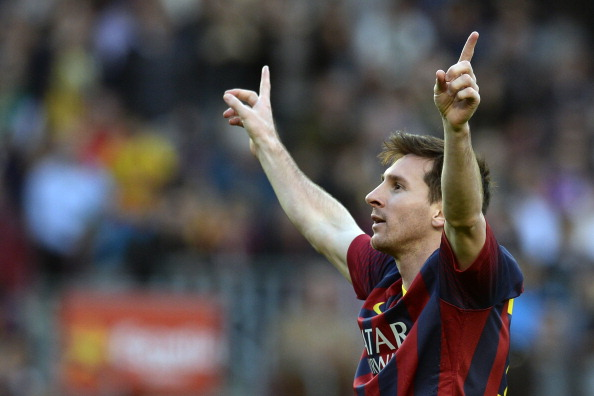 Barcelona's Argentinian forward Lionel Messi celebrates after scoring a goal during the Spanish league football match FC Barcelona vs Osasuna at the Camp Nou stadium