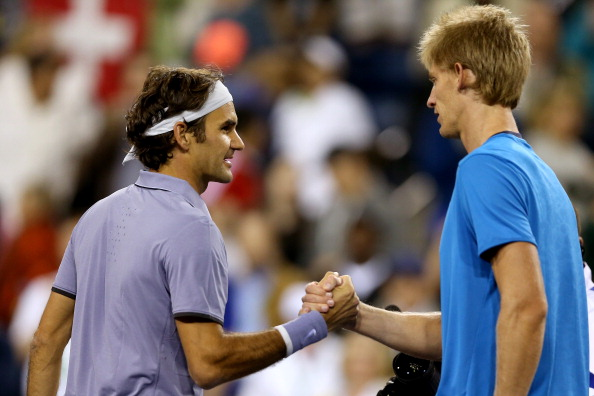 Roger Federer shakes hands with Kevin Anderson after defeating him in the Indian Wells quarterfinal