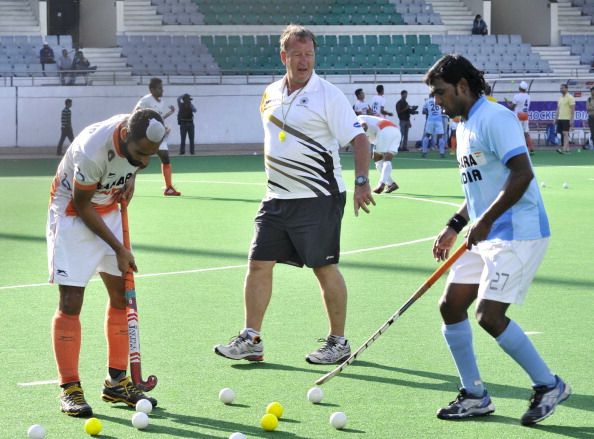Indian Hockey team coach Terry Walsh giving tips to players during the training cap at National Stadium