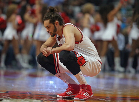 Joakim Noah #13 of the Chicago Bulls takes a moment to himself before the start of a game against the Orlando Magic at the United Center on April 14, 2014 in Chicago, Illinois. The Bulls defeated the Magic 108-95.