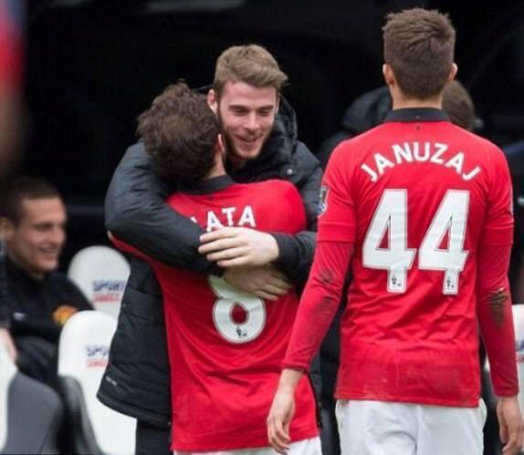 An ecstatic Mata hugs David de Gea after scoring the freekick